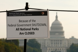 A sign on the National Mall tells visitors of the closures do to the federal government shutdown in Washington